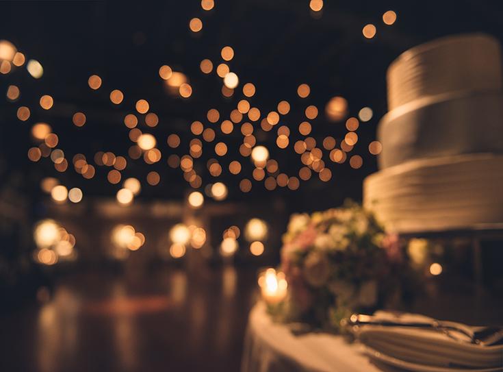 Wedding party evening. Blurred dance floor and wedding cake